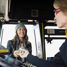 woman boarding and greeting female transit driver